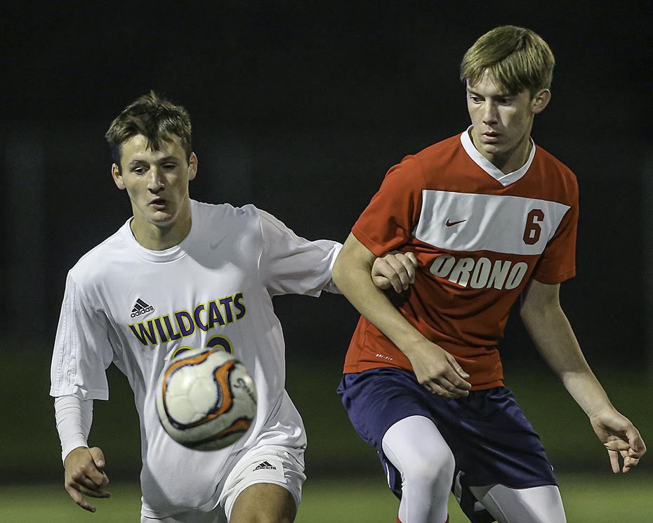 Waconia's Wallace Wisniewski and Orono's Aiden Ecker (6) keep their eyes on the ball in the second half. Photo by Mark Hvidsten, SportsEngine