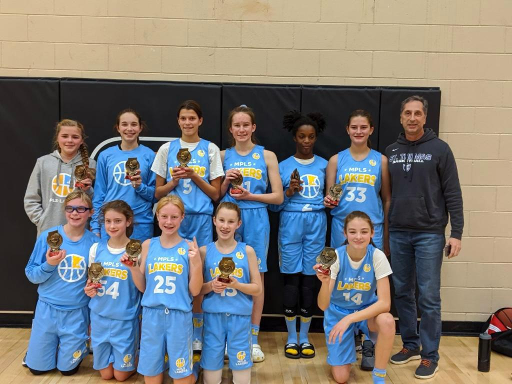 Minneapolis Lakers Girls 7th Grade Gold pose with their trophies after earning 2nd place at the Osseo Winter Shootout tournament in Osseo, MN