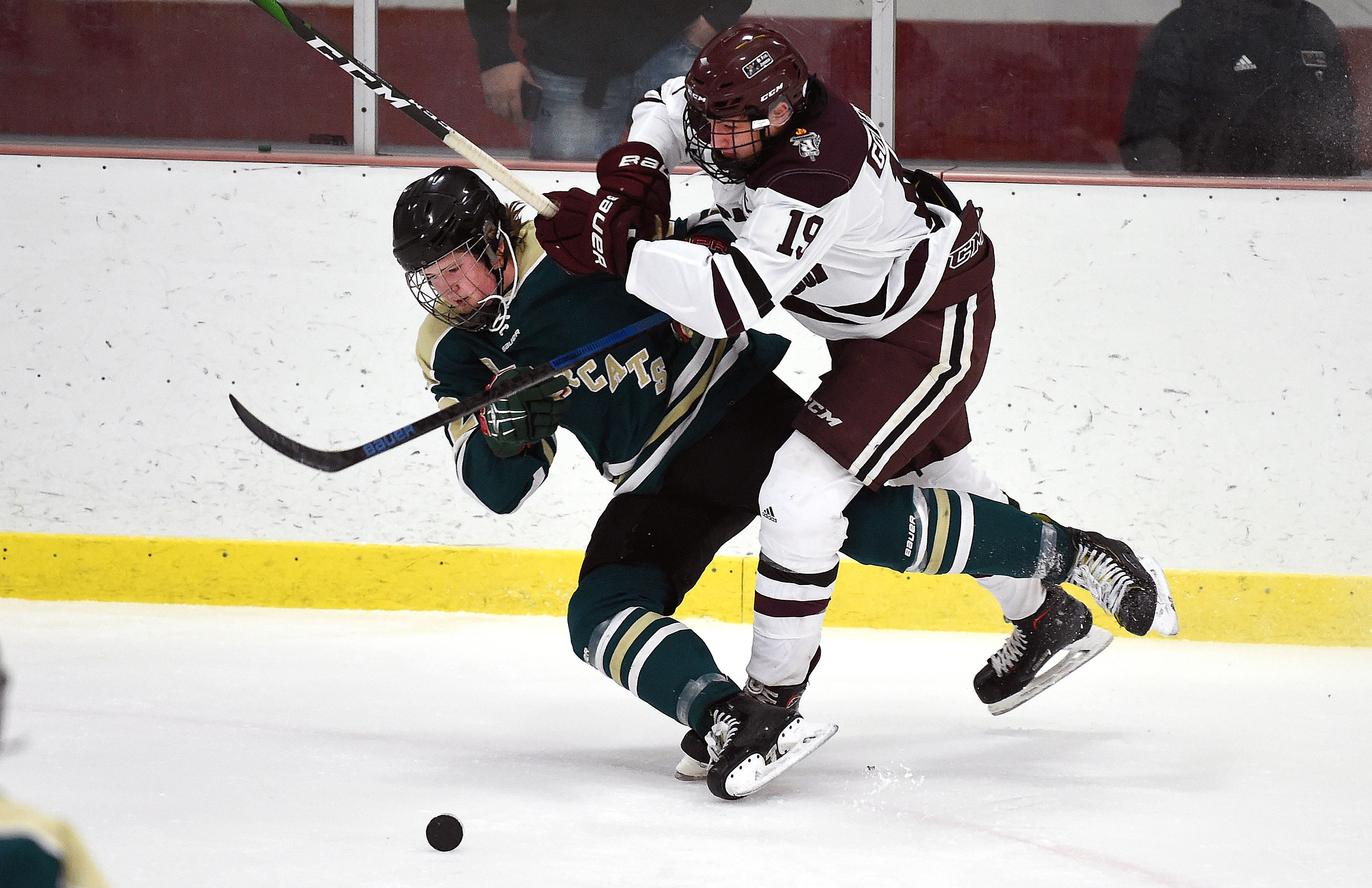 Kittson Central's Tyler Bakken, left, collides with St. Paul Johnson's Drake Teal on Saturday. Photo by Loren Nelson, LegacyHockeyPhotography.com