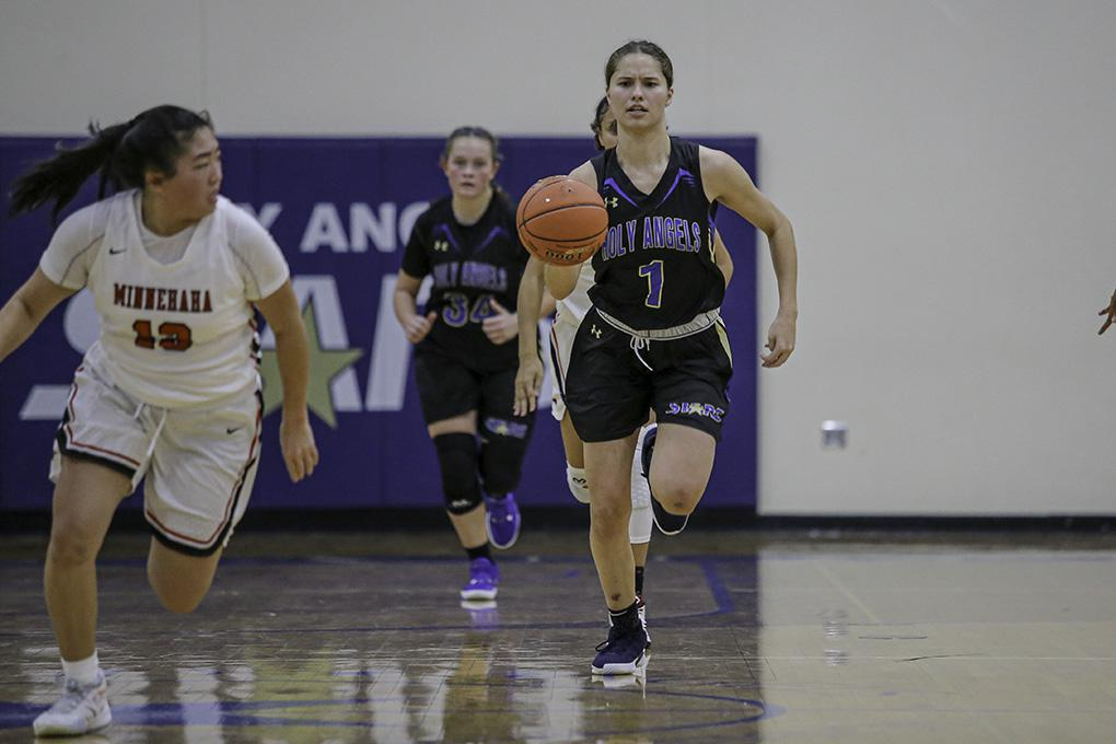 Francesca Vascellaro (1) led a break in the second half of Holy Angels' 97-55 victory over Minnehaha Academy. Vascellaro scored 16 points and reached 1,000 for her career. Photo by Mark Hvidsten, SportsEngine