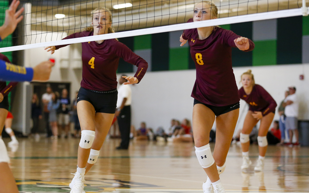 Medford's Clara Kniefel (4) and Emma Kniefel (8) prepare to go for a block against Minneota during the Breakdown Sports Side Out Classic at Edina High School. The Vikings fell to the Tigers in three sets. Photo by Jeff Lawler, SportsEngine