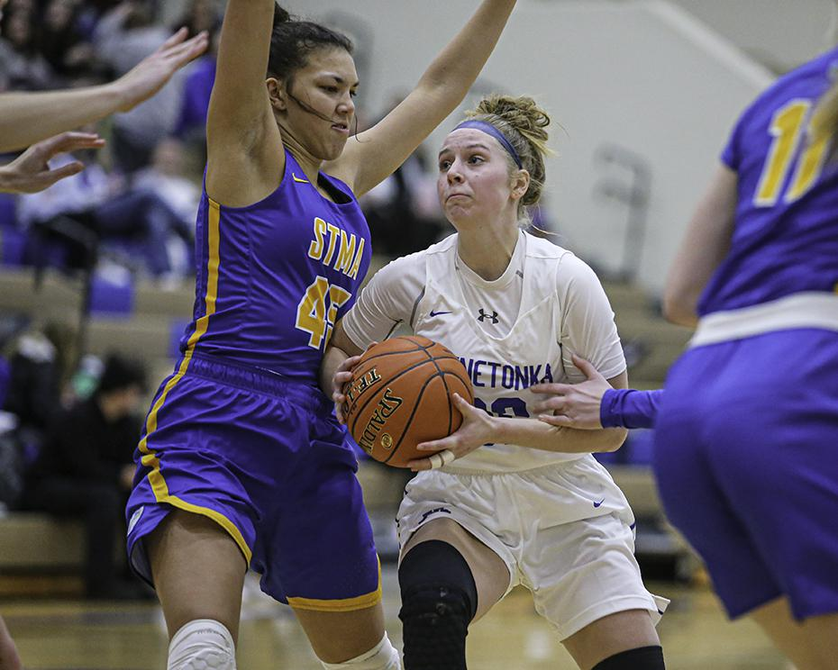 Minnetonka's Piper Terry tried to get past Knights defender Vanessa Alexander in the second half. Photo by Mark Hvidsten, SportsEngine