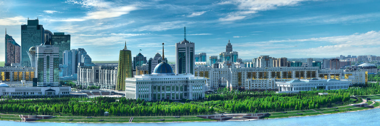 Skyline of Nur-Sultan Kazakhstan with a Golden Tower, Presidential Palace, Baiterek Tower and House of Ministries next to Ishim river
