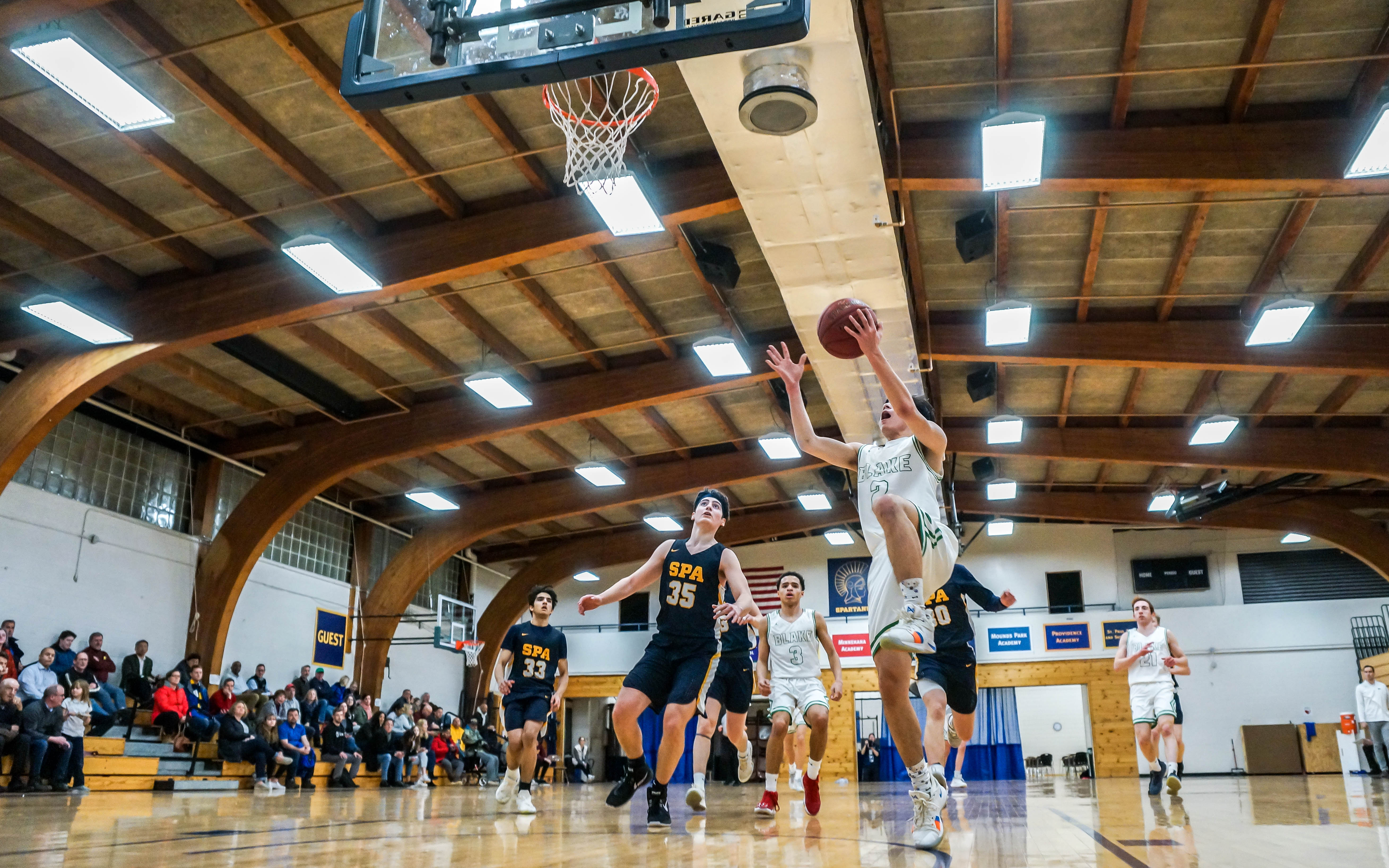 Blake's Jasper Liu with a layup on a fast break against St. Paul Academy Friday night. Liu finished with a game-high 26 points in the Bears' victory. Photo by Korey McDermott, SportsEngine