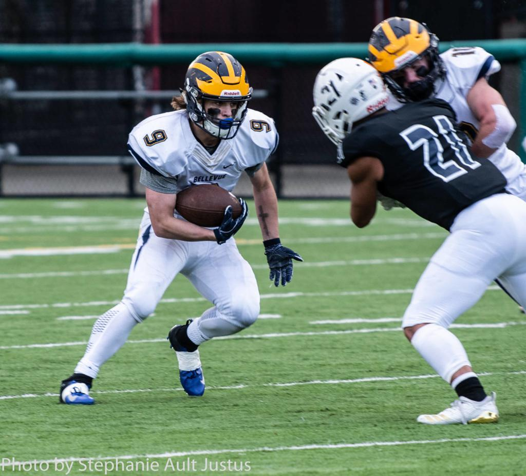 Bellevue's Joby Schneider runs the ball up field against Eastside Catholic