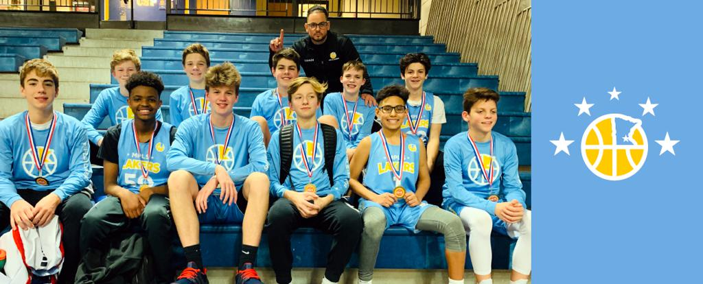 Minneapolis Lakers Boys 8th Grade Gold pose with their Medals after becoming the Champions at the Concordia Golden Bears Classic tournament in St Paul, MN