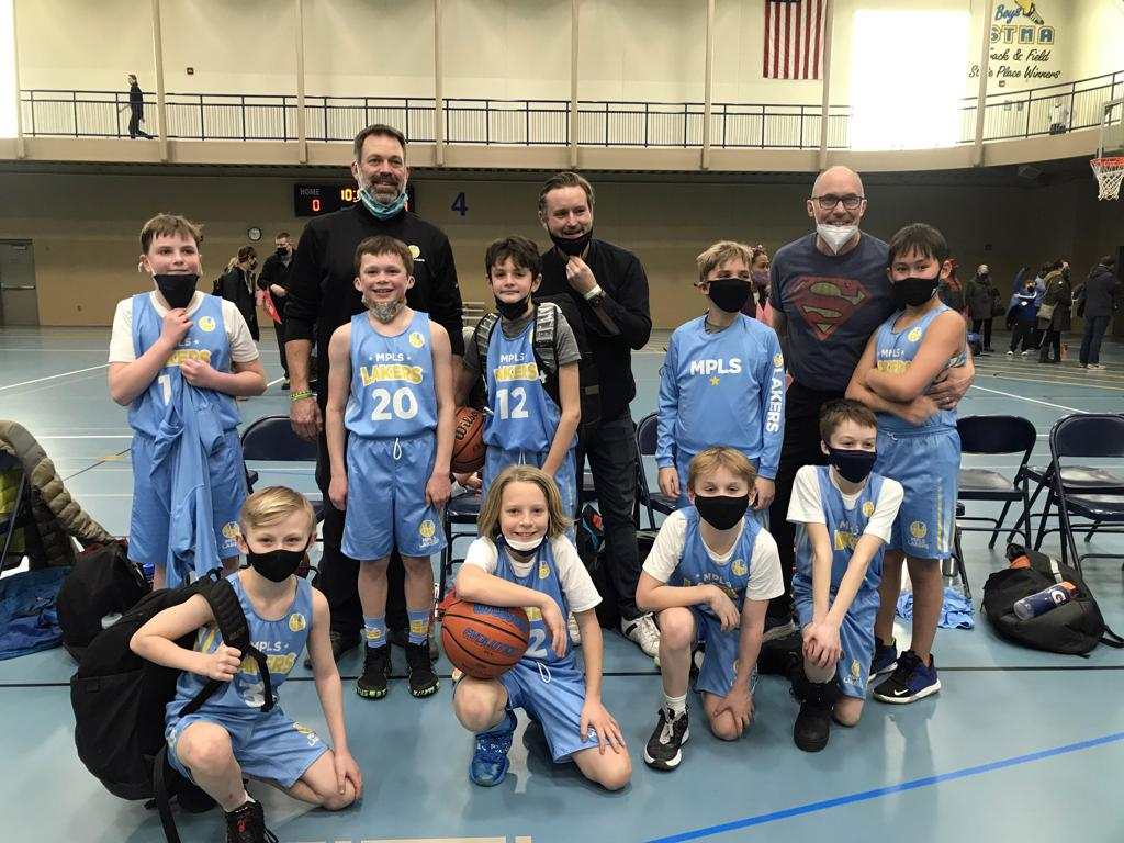 Mpls Lakers Youth Traveling Basketball Program Inc Boys 5th Grade Gold pose after becoming the Champions at the St. Michael/Albertville Shootout in Michael/Albertville, MN