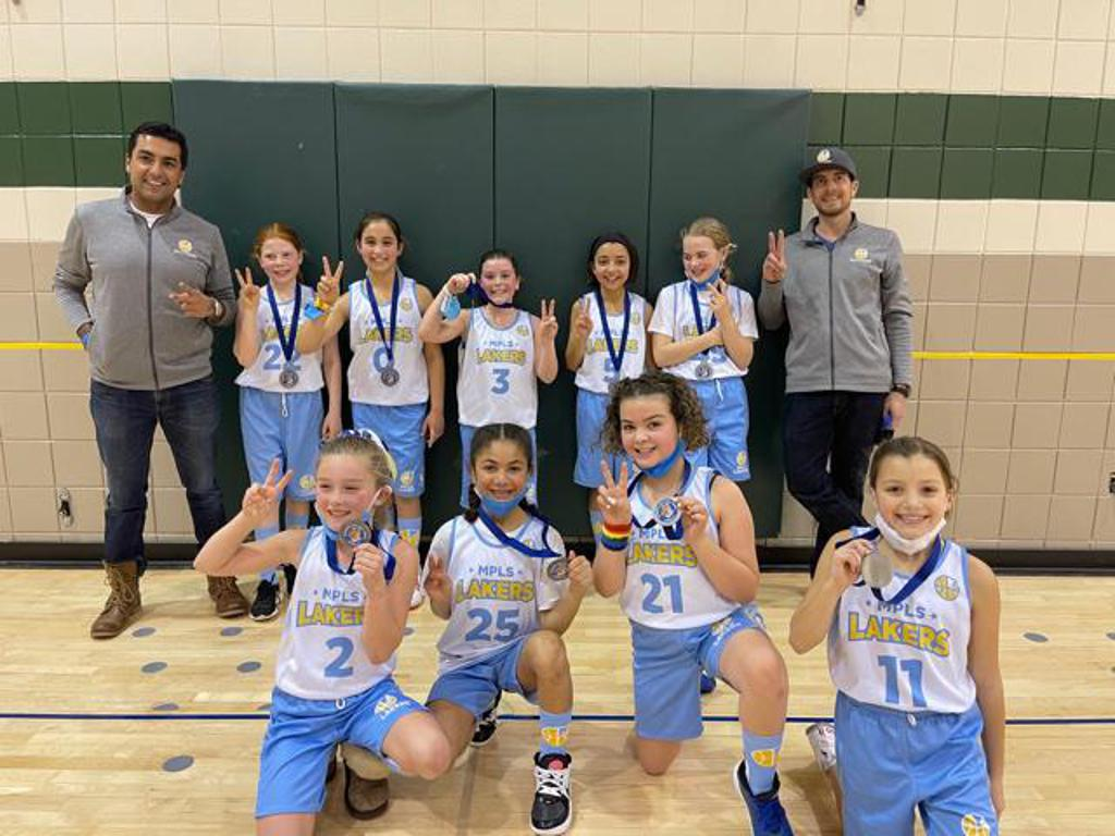 Mpls Lakers Youth Traveling Basketball Program Inc Girls 4th Grade Gold pose after placing 2nd at the Woodbury Royal Rumble tournament in Woodbury, MN