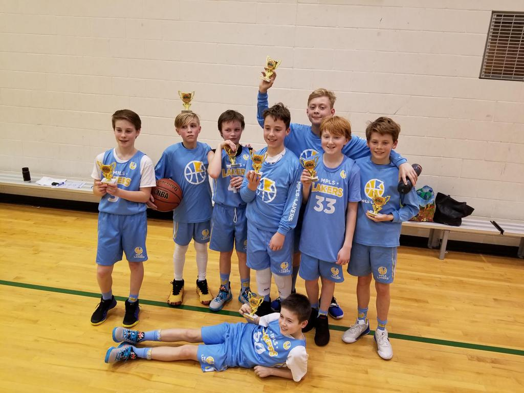 Mpls Lakers Youth Traveling Basketball Program Inc Boys 6th Grade Blue in a team huddle during a time out at Edina Cake Eater Classic tournament in Edina, MN