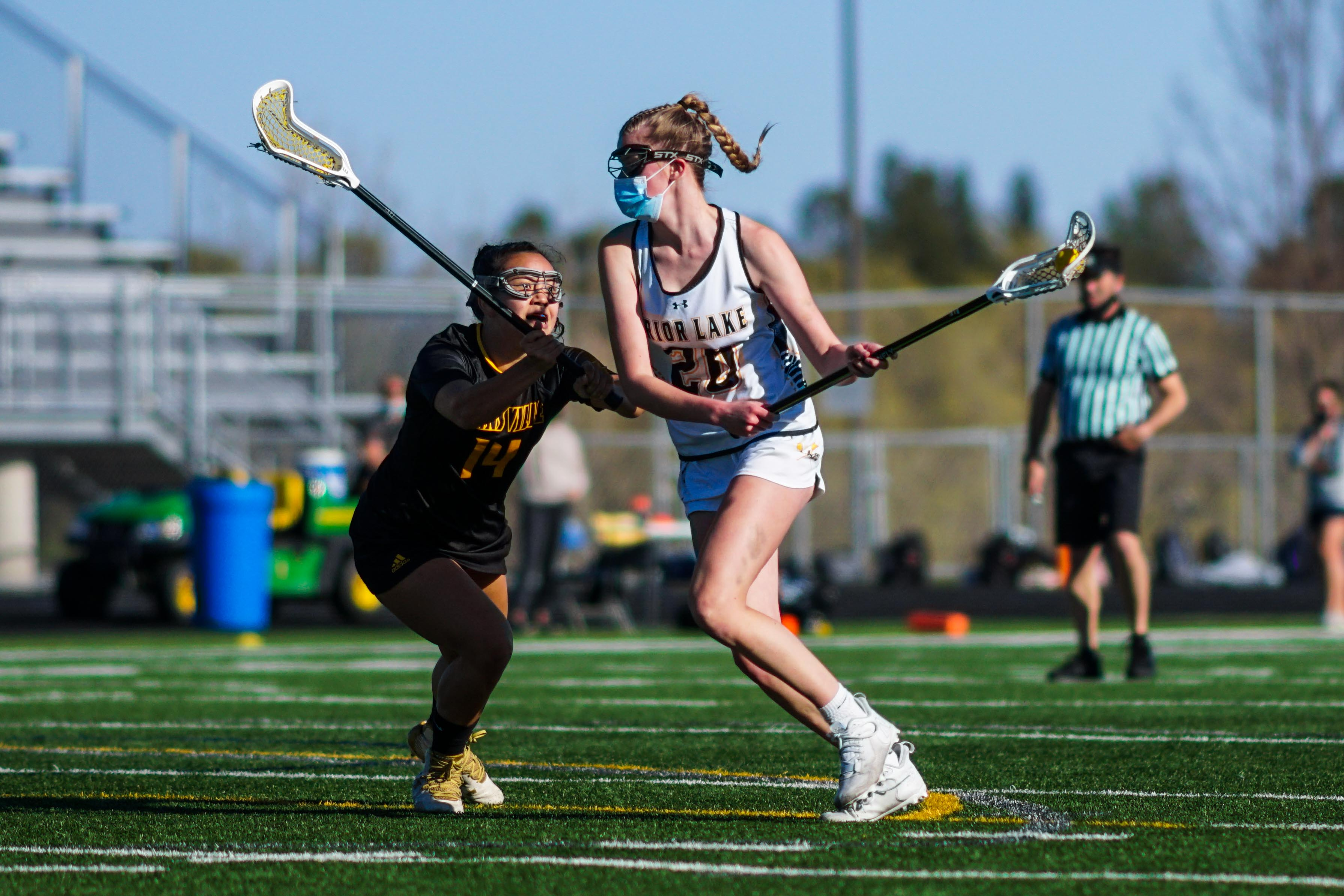 Prior Lake's Payton Bloedow (20) tied teammate Ava Schiltz with a game-high four goals in a convincing 16-3 victory over Apple Valley/Burnsville Thursday night. Photo by Korey McDermott, SportsEngine