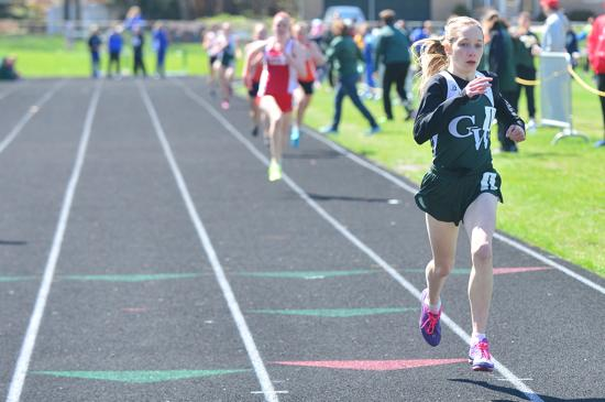 Glenbard West's Lindsay Graham opens up a gap in the final lap of the 1,600-meter run.