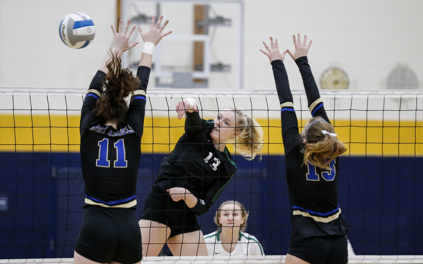 Concordia Academy's Kira Fallert (13) goes up for one of her 19 kills against Holy Angels Saturday afternoon. The Beacons advanced to the Class 2A state tournament with a three sets to none victory over the Stars. Photo by Jeff Lawler, SportsEngine