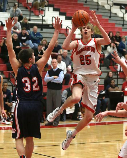 Barrington's Rapolas Ivanauskas (25) drives to the basket over Conant's Daniel Sotos on Jan. 18.