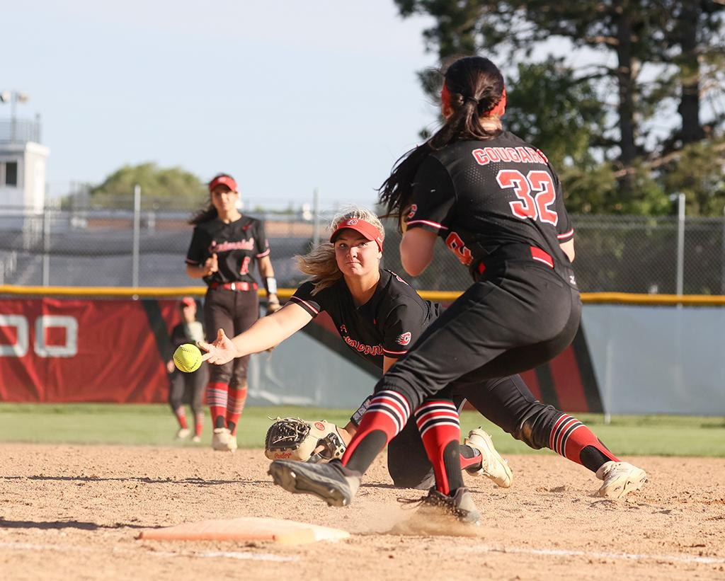 First baseman Maddy Ringen picks up a ground ball and tosses it to Adrianna Thomas (32) for the final out in the game. Ringen scored the second of three runs in the fifth inning for Centennial. Photo by Cheryl A. Myers, SportsEngine