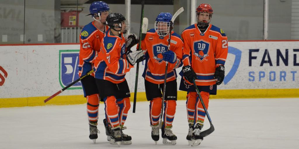 DB Hockey Academy players celebrating a goal