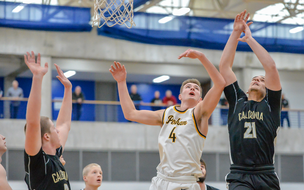 Perham's Josh Jeziorski (4) goes to the net in the first half against Calendoria Saturday. The Yellowjackets beat the Warriors 66-61 in the Breakdown Tip Off Classic. Photo by Earl J. Ebensteiner, SportsEngine