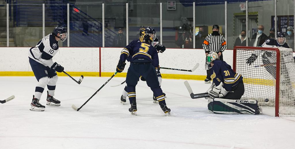 Tommy Deverell (10) launches the puck past goaltender Joey Hegarty (31), scoring a power-play goal midway through the first period. Deverell scored again in the second period en route to a 6-1 win over Rosemount. Photo by Cheryl A. Myers, SportsEngine