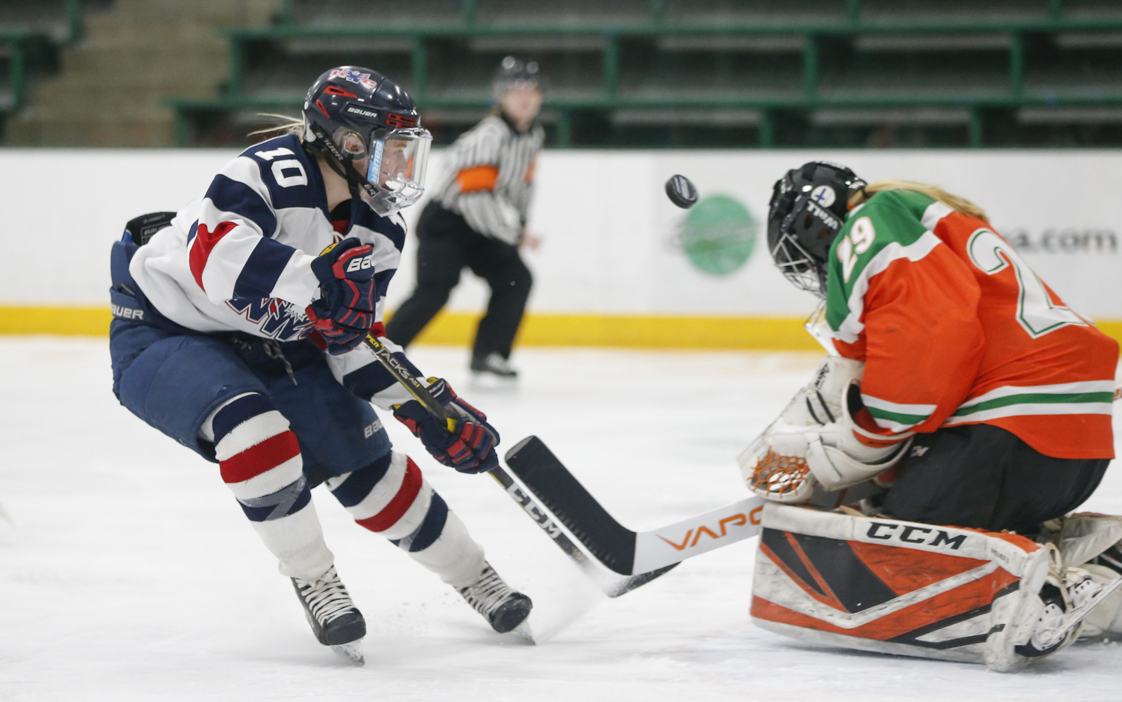 North Wright County's Mackenzie Bourgerie (10) tries to track down a rebound against Grand Rapids/Greenway Thursday afternoon. Bourgerie had a goal and an assist in the the River Hawks' 4-1 victory over the Lightning. Photo by Jeff Lawler, SportsEngine