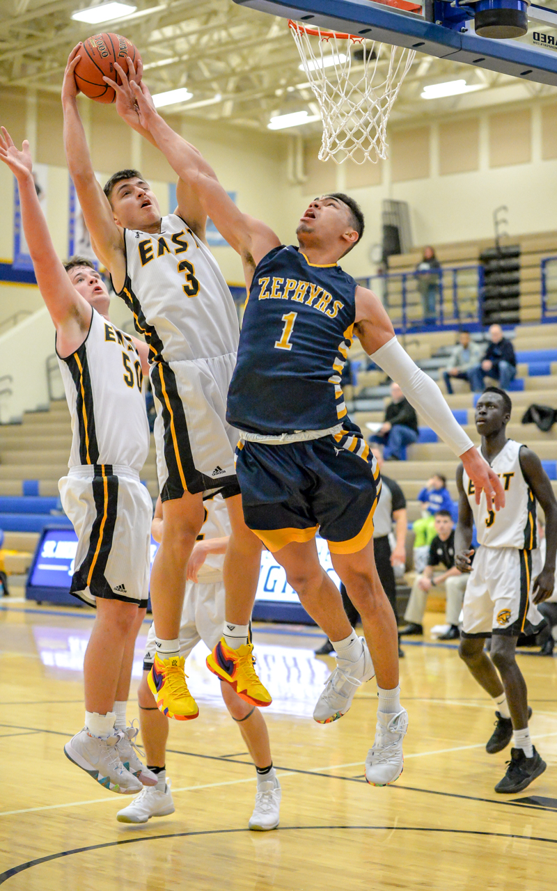 The Cougars' Jax Madson (3) drives to the basket in the second half. He was the Cougars' leading scorer with 24 points. The Cougars beat the Zephyrs 66-64 in the Breakdown Community Clash on Saturday afternoon. Photo by Earl J. Ebensteiner, SportsEngine