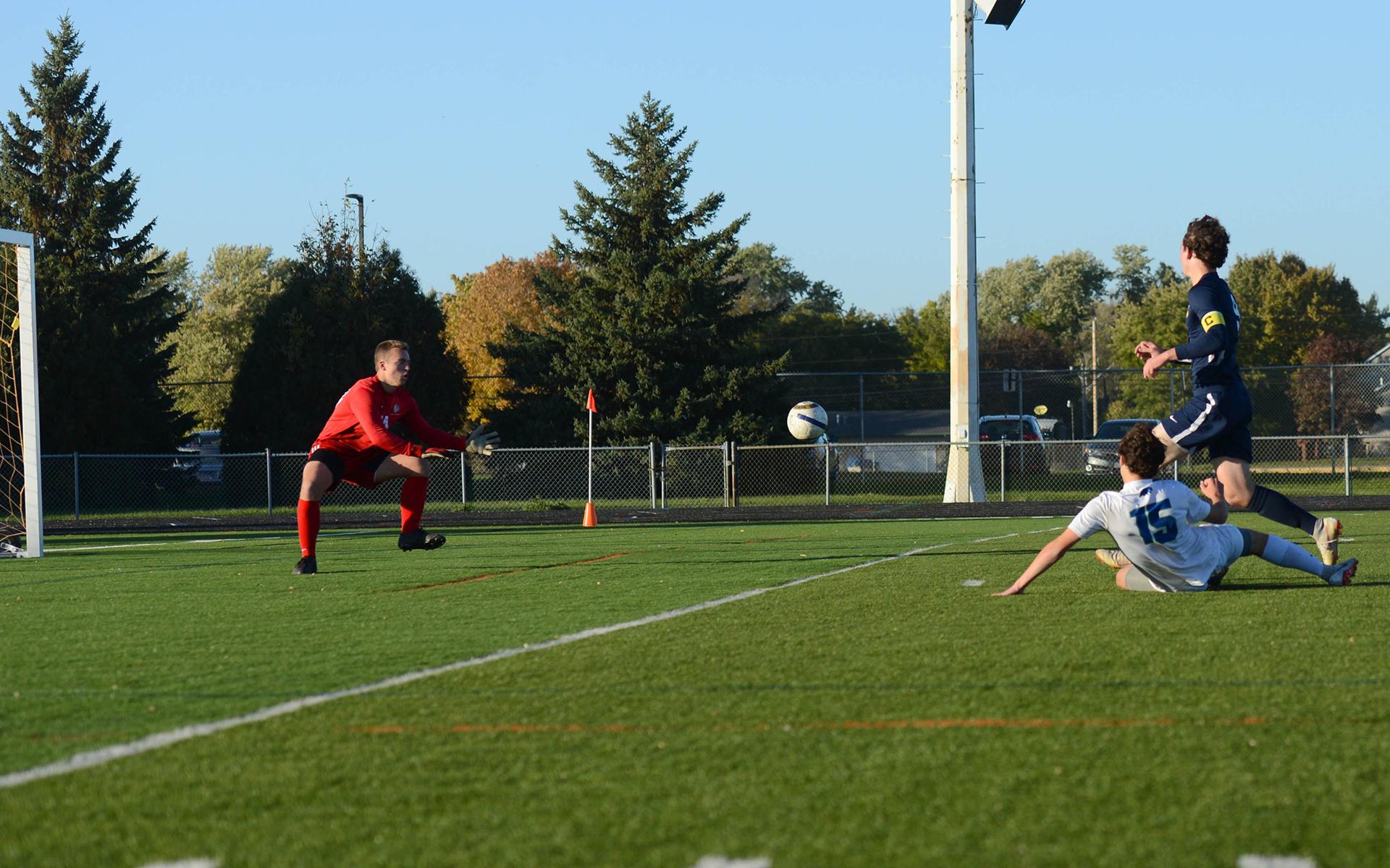 Blake defender Jake Shapiro scores the first goal of the game against Totino-Grace.  Photo by Carter Jones, SportsEngine.