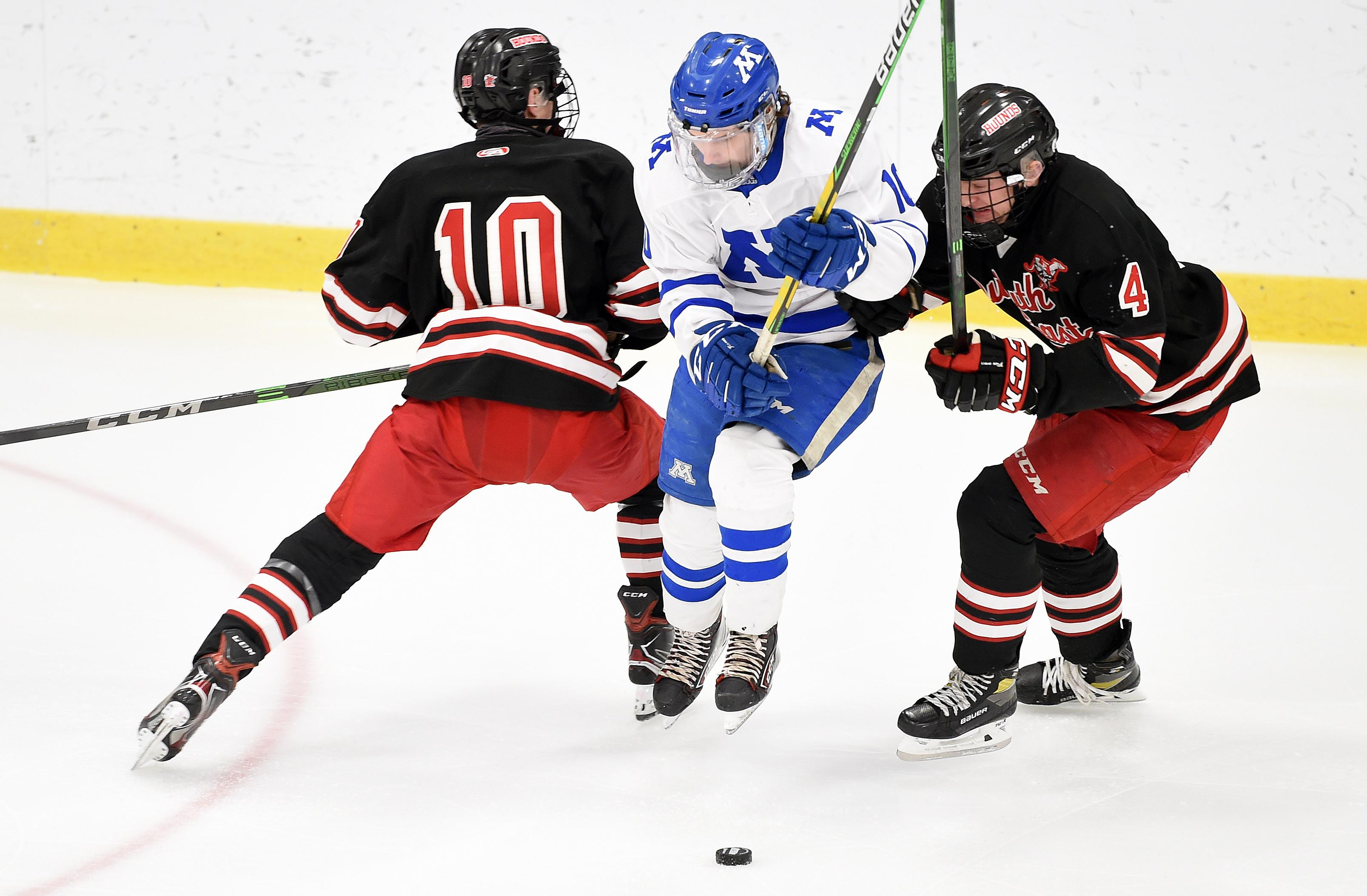 Minnetonka's Hunter Newhouse splits the Duluth East defense during Thursday night's game at the Pagel Activity Center. Newhouse had two first-period goals. Photo by Loren Nelson, SportsEngine