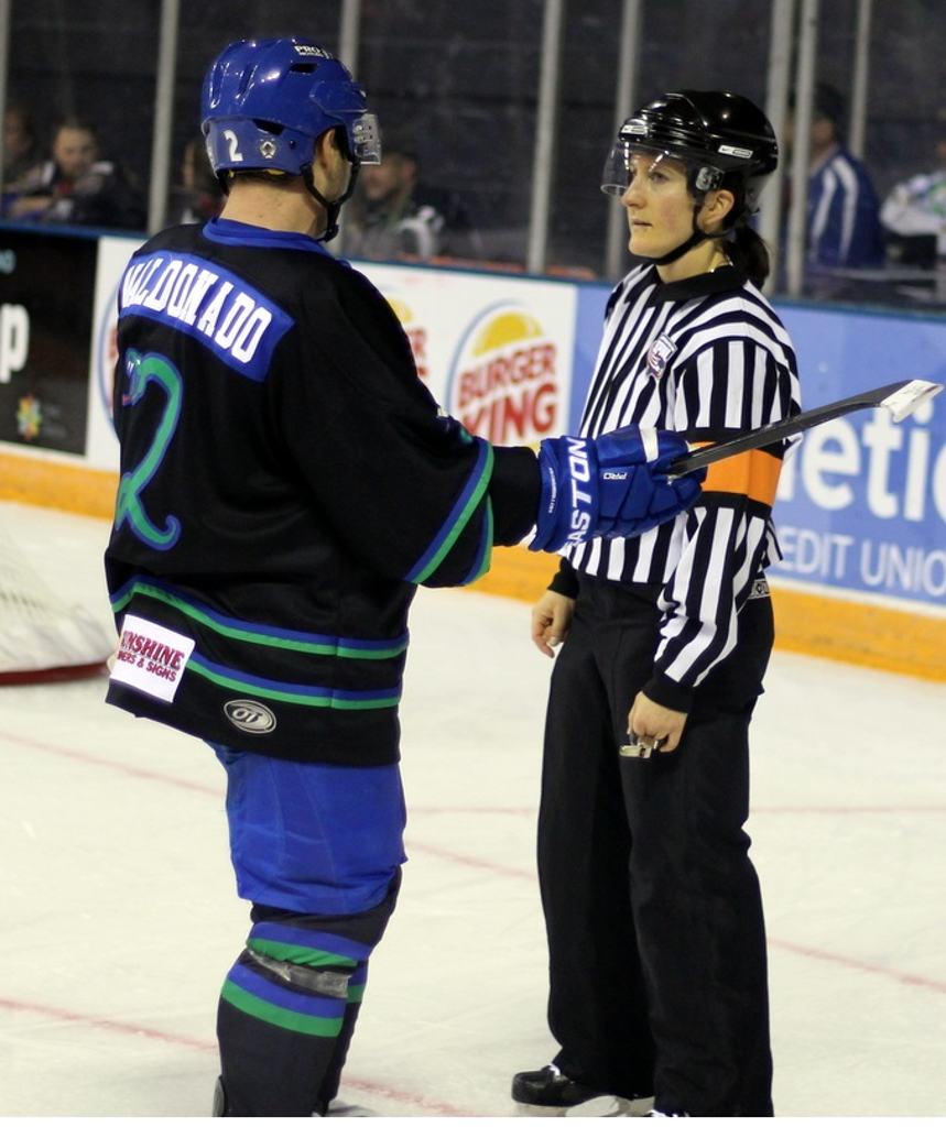 Katie Guay discusses a rule interpretation with a player.