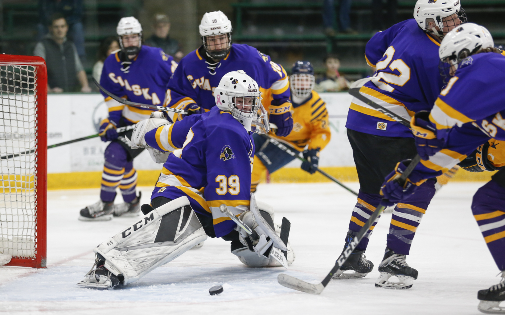 Chaska goalie Carter Wishart (39) lunges toward a loose puck as it slides across the crease during Saturday afternoon's game against Prior Lake. Wishart had 19 saves in the Hawks' 4-1 victory over the Lakers. Photo by Jeff Lawler, SportsEngine