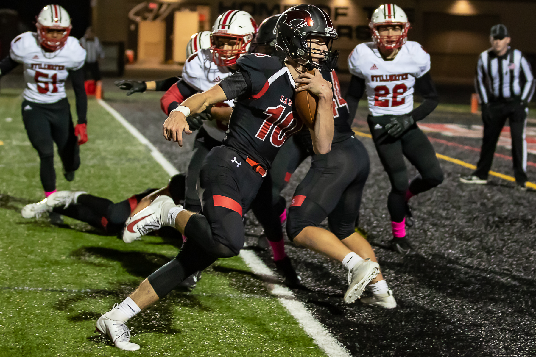 Shakopee quarterback David Bigaouette gave his team an early 13-0 lead over Stillwater. Bigaouette finished with four touchdowns, leading the Sabers to a 34-7 homecoming victory on Friday night at Vaughan Field. Photo by Gary Mukai, SportsEngine