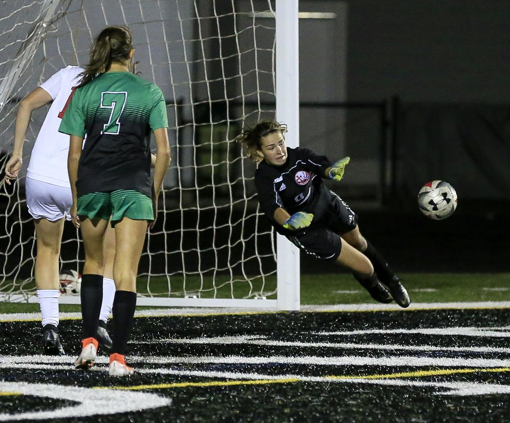 Goalkeeper Kate Norman makes a diving save in the second half to keep Visitation within a goal of Hill-Murray. The No.6-1A Blazers and the No.2-1A Pioneers finished overtime tied at two goals apiece. Photo by Cheryl Myers, SportsEngine