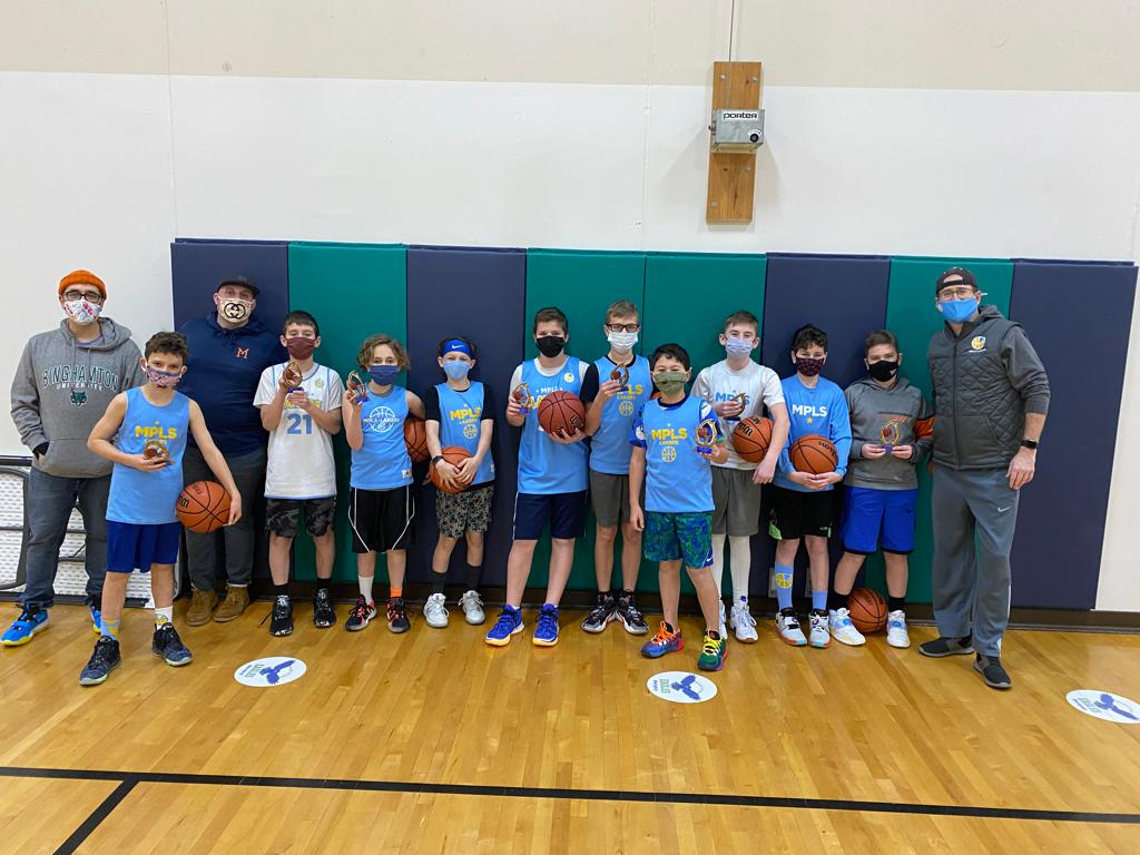Mpls Lakers Youth Traveling Basketball Program Inc Boys 6th Grade Blue pose with their trophies after becoming the Champions at the MYAS STMA Winter Shootout in Albertville, MN