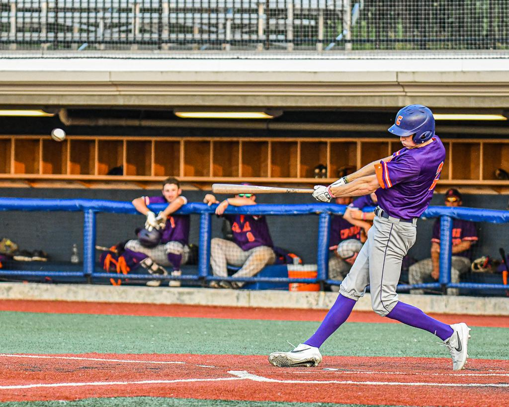 Cortland Crush Jack Lynch (2) hits the ball against the Syracuse Spartans in New York Collegiate Baseball League action at OCC Turf Field in Syracuse, New York on Wednesday, July 10, 2019. Cortland won 12-2.