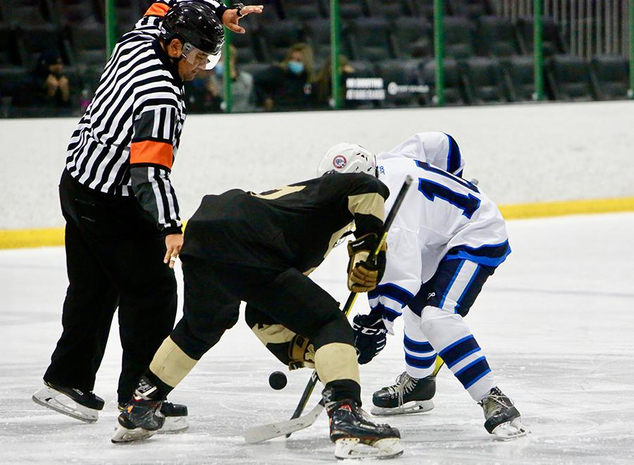 Prep skaters fight for puck possession off a faceoff during a CPHL Early Bird Tournament matchup on Aug. 31 at the Sport Stable in Superior. Photo by Steven Robinson, SportsEngine