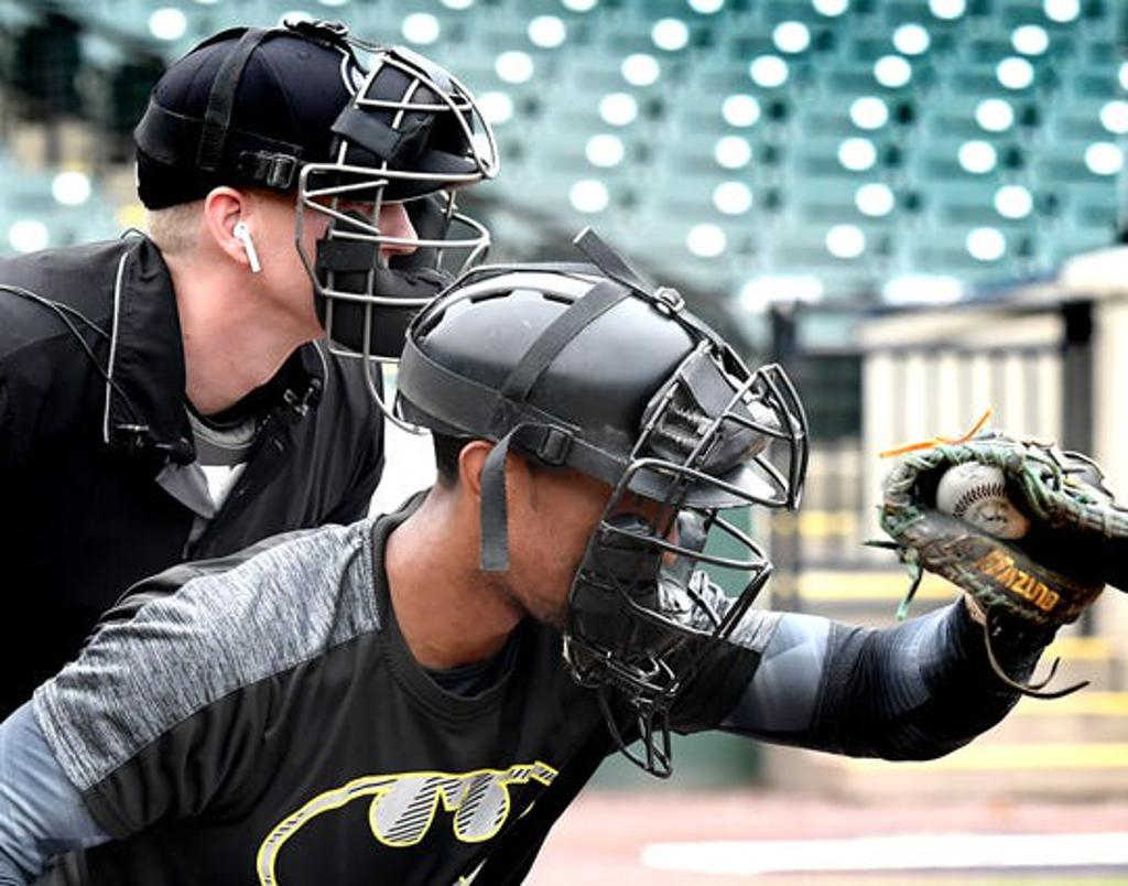 Atlantic League umpire Brian deBrauwere wears an earbud behind Revolution catcher James Skelton during a demonstration of the automated ball-strike system at PeopleBank Stadium Monday, July 8, 2019. The system, sanctioned by Major League Baseball, will ma