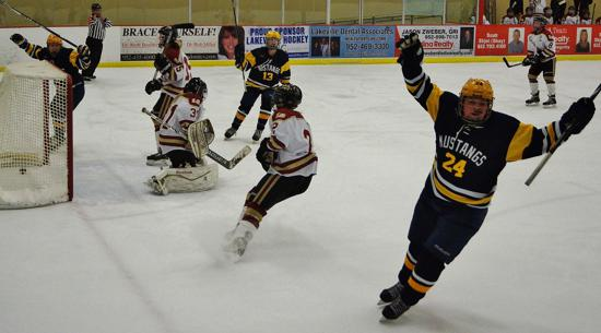 Breck's Sydney Breza (No. 24) celebrates scoring in Breck's 5-3 win over Lakeville South last year. Photo credit: YHH.