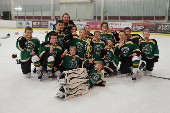 """The Mounds View/Irondale Peewee A team earned a """"taste"""" of victory in the championship game of the Super Rink Spectacular. Credit: Peter Odney."""