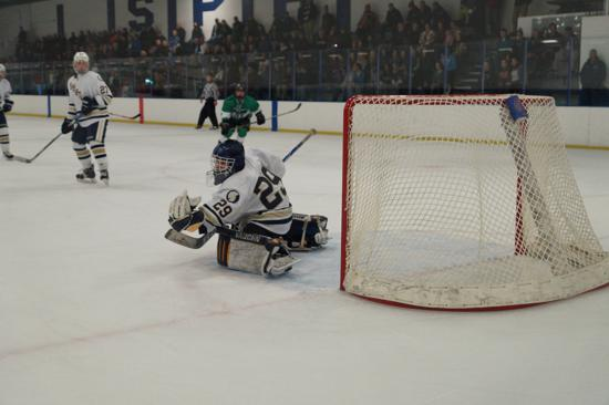 St. Paul Academy sophomore Andy Beran makes one of his 27 saves in Saturday's 7-3 win over East Grand Forks. Credit: Peter Odney.