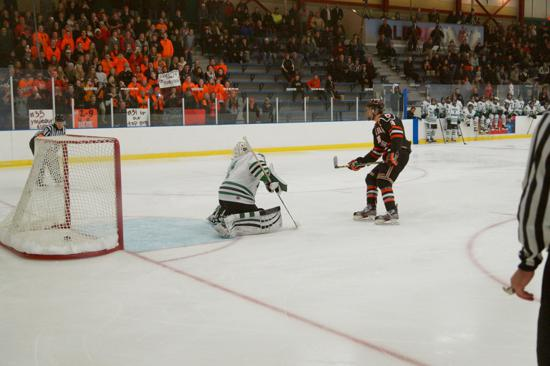 Wyatt Newpower scores on a penalty shot for White Bear Lake in the Bears' 5-2 loss to Hill-Murray. Credit: Peter Odney.