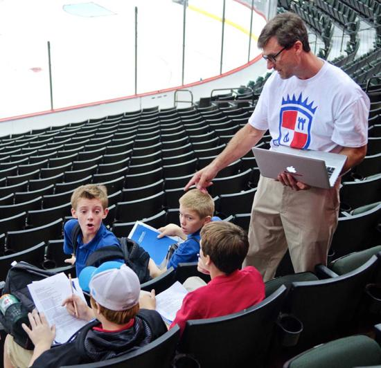 Dave Snuggerud instructing students at Xcel Energy Center. Credit: Breakaway Academy.