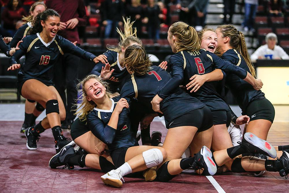Jasmine Weidemann, left, celebrated with her Lakeville South teammates after a five-set victory over Lakeville North in the Class 3A, Section 1 volleyball championship game. Photo by Mark Hvidsten, SportsEngine