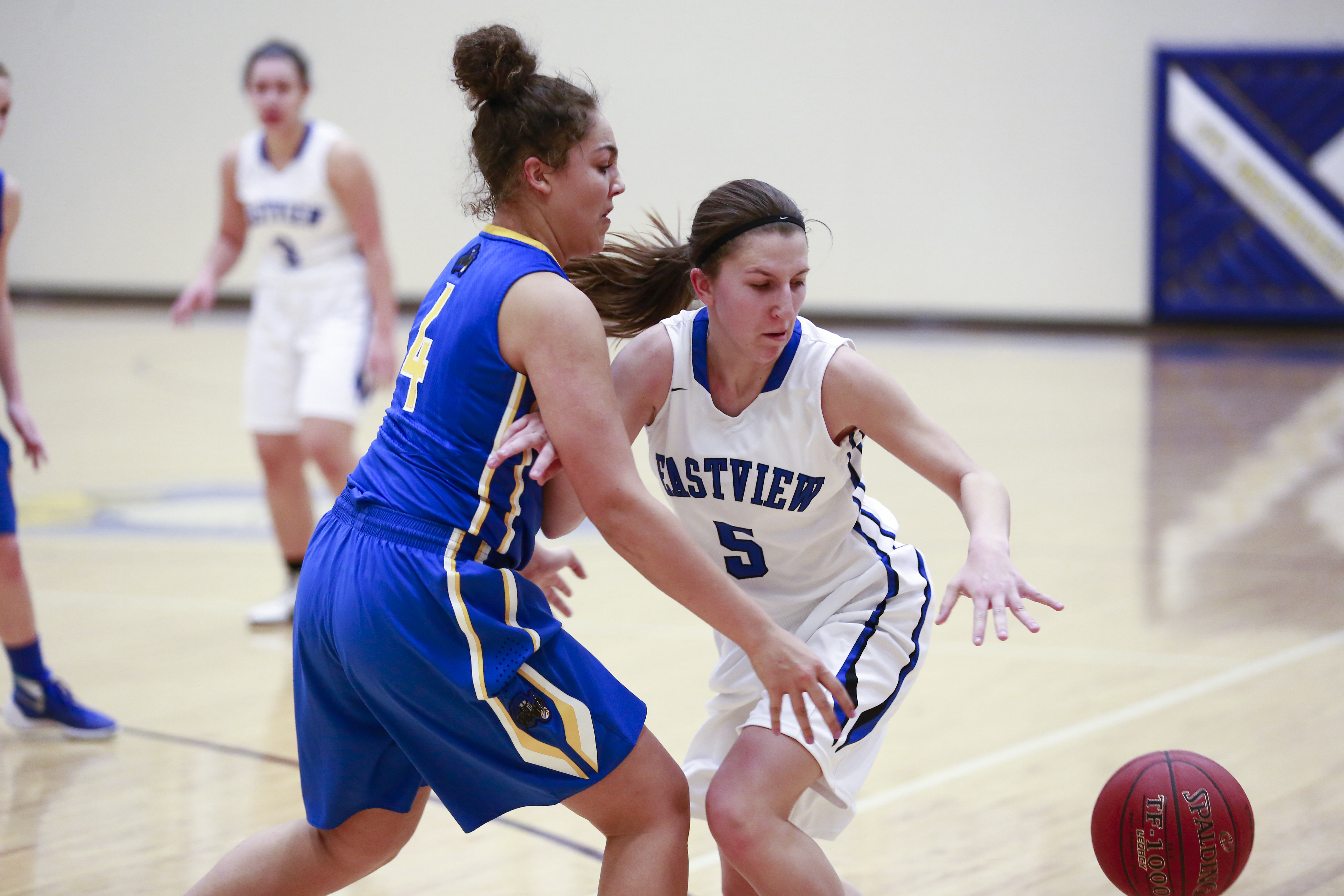 Eastview Lightning's Allie Pickrain (5) dribbles the ball in St Michael-Albertville's defensive zone. Allie scored 26 points including 2 late game free-throws to help Eastview secure the victory 77-66 away in St. Michael. Photo by Chris Juhn