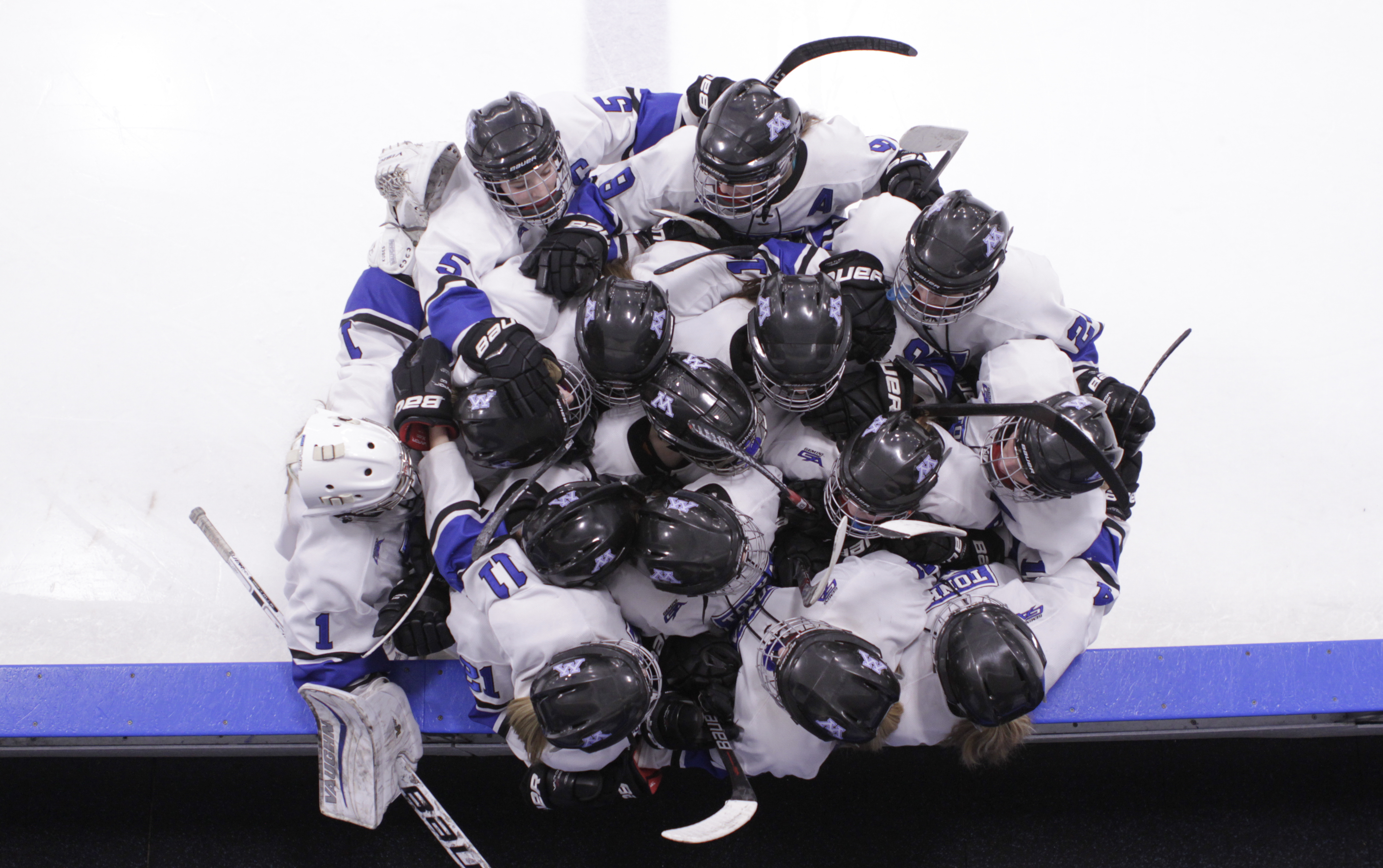 The Minnetonka Skippers huddle on the ice at the beginning of the second period at home at the Pagel Activity Center in Minnetonka. Photo by Chris Juhn