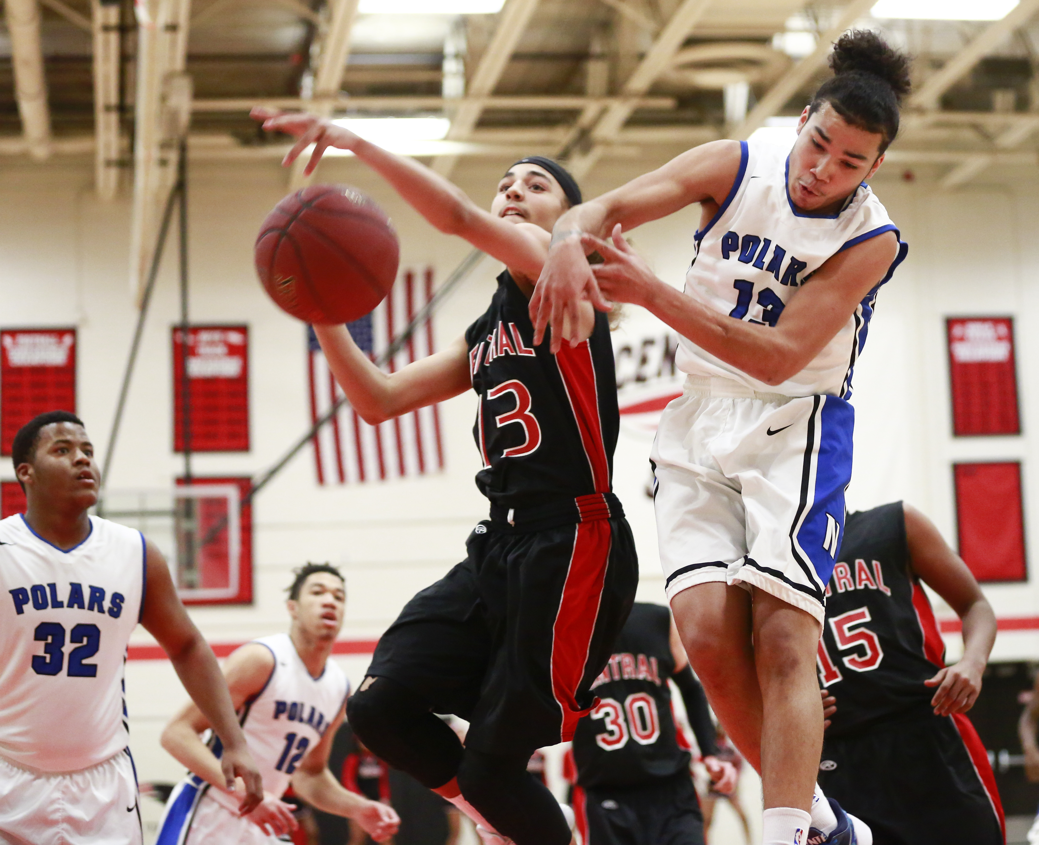 Minneapolis North's Patrick Dembley (13) knocks the ball away as St. Paul Central's Re-Twan Balenger (13) was attempting a slam dunk in the Polars' 83-71 road victory Thursday night. Photo by Chris Juhn