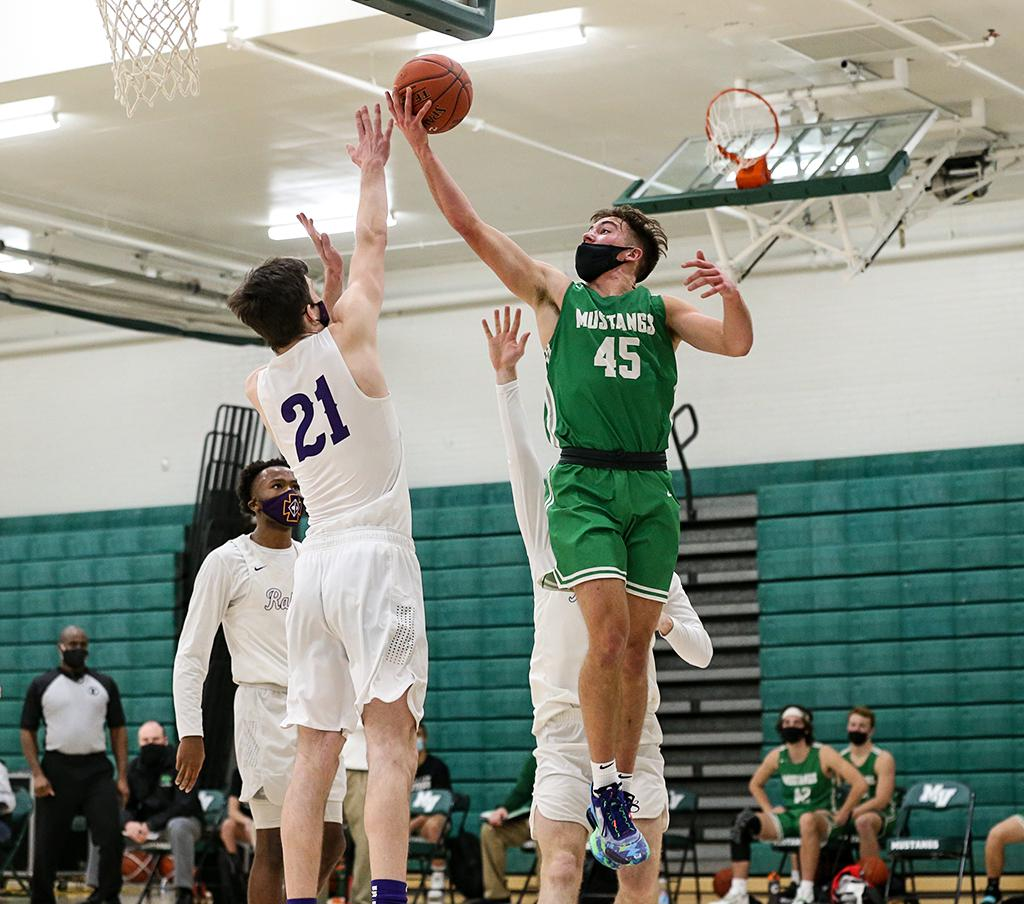 Mounds View's Dylan Wheeler (45) lays the ball up over Cretin-Derham Hall's Jack Plum (21) in the second half. The Mustangs opened the season with a 64-51 win over the Raiders on Friday night. Photo by Cheryl A. Myers, SportsEngine
