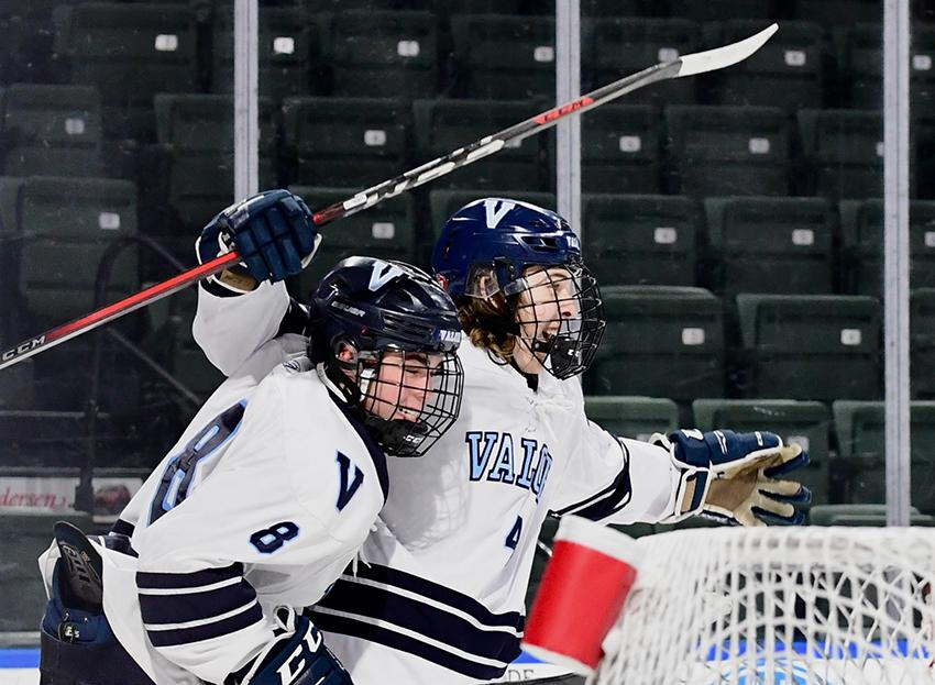 Valor Christian's Logan Buchanan (8) and Ryan Kayser (4) celebrate during Thursday's Class 5A state title game. Buchanan logged two assists and Kayser scored twice in the Eagles' 4-3 defeat of Fort Collins. Photo by Steven Robinson, SportsEngine