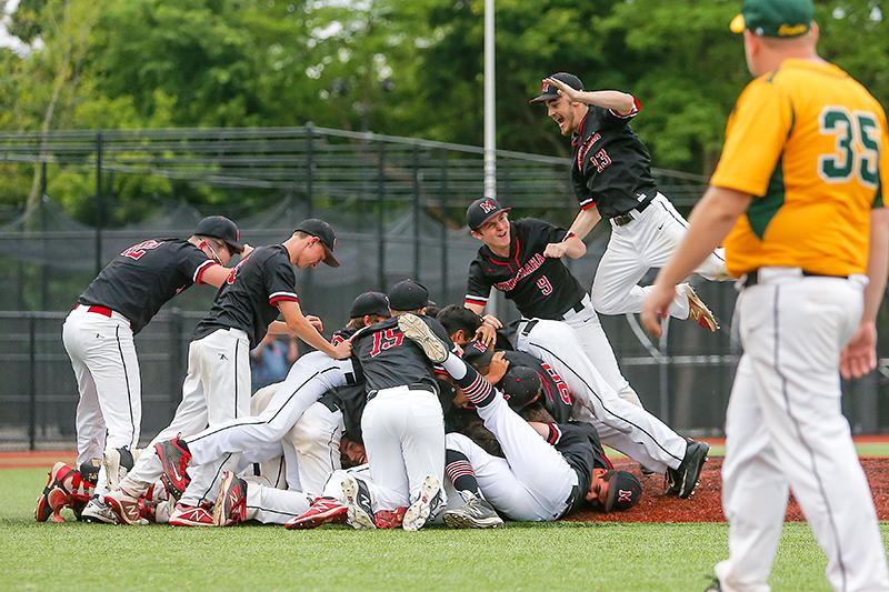 Outfielder Conor Johnson (13) leaps into the celebratory pile after Minnehaha Academy wrapped up its 9-1 victory over New Life Academy in the Class 2A, Section 4 championship and earned its fourth consecutive state tournament berth. Photo by Mark Hvidsten
