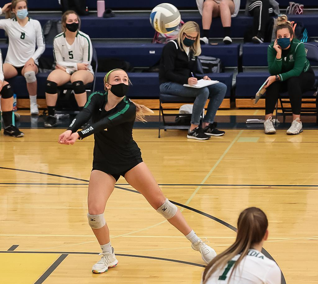 Senior liberto Grace Landvik sends the ball to the front line. Landvik's 18 digs and four aces helped Concordia Academy to victory on Wednesday night. Photo by Cheryl A. Myers, SportsEngine