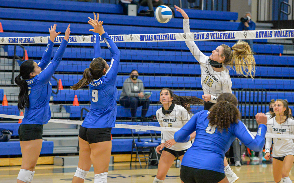 East Ridge's Camryn Greenwald (13) goes up for the kill shot Thursday night in the Raptors' 3-0 defeat of Woodbury at Woodbury High School. Photo by Earl J. Ebensteiner, SportsEngine