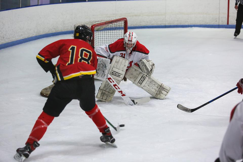 Cameron Schoffman (31) made 45 saves, including turning awaymultitude of shots during a barrage in the third period, to help Heritage earn a 3-3 overtime tie with Castle View in a CPHL matchup on Nov. 7. Photo by Katie Hinkle, SportsEngine