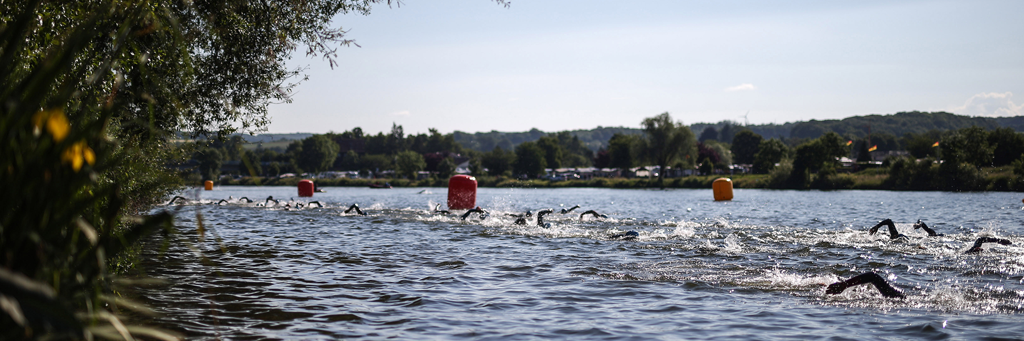 IRONMAN 70.3 Luxembourg athletes are swimming in the Moselle river which separates Germany and Luxembourg