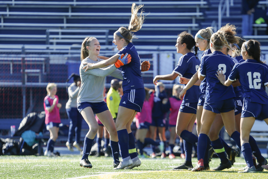 Breck senior Kaitlyn MacBean celebrates her goal on the opening kickoff against Rochester Lourdes with goalkeeper Jennie Ehlert (left). The Mustangs defeated the Eagles 1-0 Saturday morning in Golden Valley. Photo by Jeff Lawler, SportsEngine